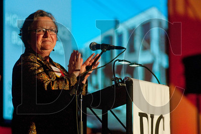 Debbie Kitchin, president of the board of directors of the Energy Trust of Oregon, applauds after announcing that the Hawthorne Depot project won Energy Trust's High Performance Building Awards' Major Renovation award.