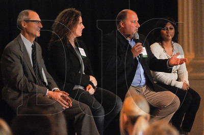 Larry Gescher, third from left, speaks during the event's panel discussion. Also pictured, from left, are co-panelists Bart Eberwein, Megan Neill, and Shilpa Vepakomma.