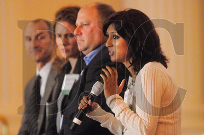 Shilpa Vepakomma, right, a construction manager with Intel, speaks during a panel discussion. Also pictured, from left, are panelists Bart Eberwein of Hoffman Construction, Megan Neill of Multnomah County, and Larry Gescher of HP Civil Inc.