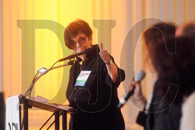 Lois Cohen, president of Lois D. Cohen Associates, moderates the event's panel discussion.