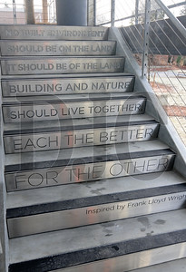 A quote inspired by Frank Lloyd Wright adorns a stairway in the parking garage.