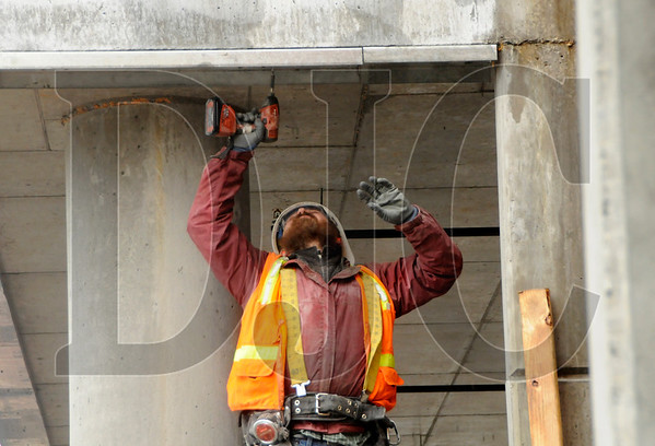 Lazar Bodunov, a steel stud framer with minority-owned Union Construction LLC, works at the site of the Killingsworth Station development in Portland on Friday.