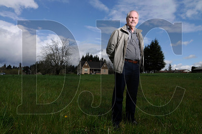 Lynn Wiley, president of L & C Wiley Inc., stands at the site of what was to become the Hawthorn Acres subdivision in Vancouver.
