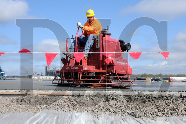 Kevin Strickland, a cement finisher with Howard S. Wright, works at the site of a 413,000 square foot industrial building at the Rivergate III Corporate Center near the Port of Portland on Thursday.  Sam Tenney/DJC
