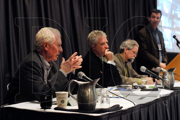 Dennis Wilde, far left, of Gerding Edlen, answers an audience question during a session on Net Zero buildings.  Pictured are, from left, Wilde, Steve Straus of Glumac, moderator John Jennings of Northwest Energy Efficiency Alliance, and John Breshears of Architectural Applications.