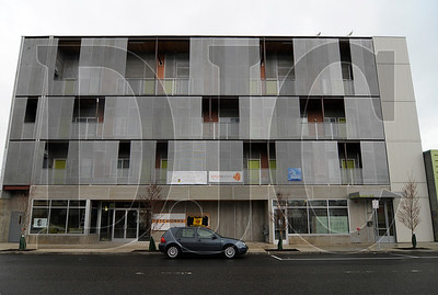 The recenty completed ecoFLATS building, which contains 18 residential units and two retail spaces, aims to be the country's first net-zero apartment building.  Sam Tenney/DJC