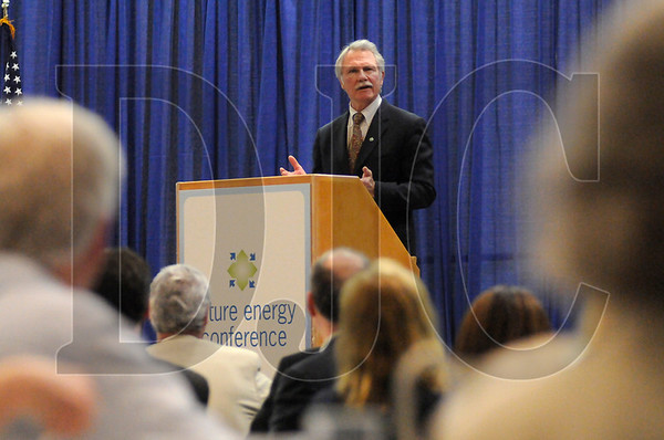 Gov. John Kitzhaber outlines his 10-year energy plan in a speech to attendees of the Future Energy Conference at the Oregon Convention Center on Wednesday.