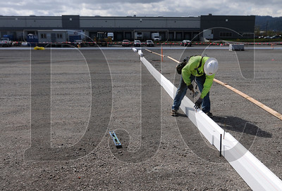 Journeyman carpenter Christian Thompson, an employee of Howard S. Wright, sets slab edge form at the site of an industrial building project near the Port of Portland on April 7.