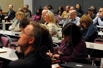 Conference attendees listen to a presentation about Net Zero buildings.