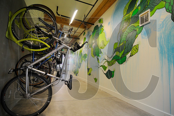 Bicycles are stored in the lobby of ecoFLATS, apartment building geared toward sustainability on North Williams Avenue in Portland.    Sam Tenney/DJC