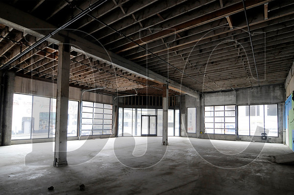 Renovation work is underway on a building on the 1400 block of Northwest Flanders Street.  The 20,000 square foot warehouse building has been divided into five spaces and received a seismic upgrade, new storefront windows, skylights, and roll-up doors.  Sam Tenney/DJC