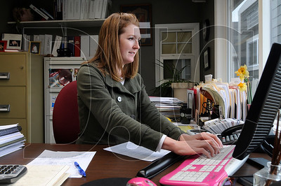 Interstate Roofing owner Shelley Metzler works in her office in Portland on Wednesday.  Sam Tenney / DJC