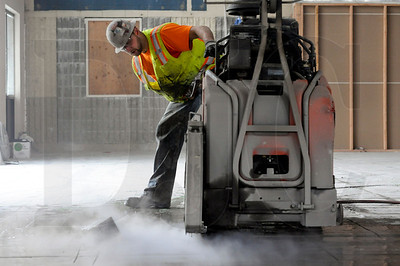 Brent Randall, a concrete cutter with Brothers Concrete Cutting, cuts concrete in the foundation of a former tire warehouse being converted into a deli and convenience store at the Jubitz Travel Center in North Portland April 11.