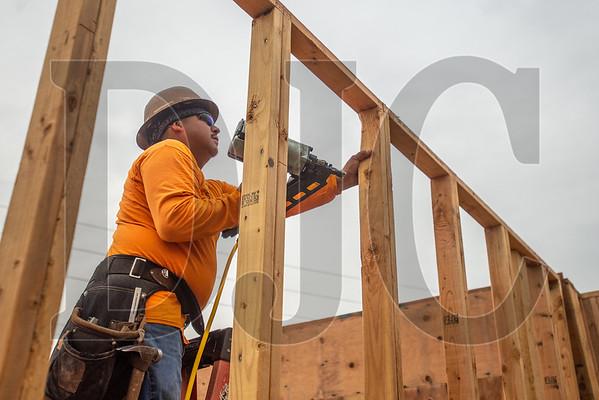Jose Angel, a carpenter with Jose Luis Morales Construction, frames interior walls. (Josh Kulla/DJC)