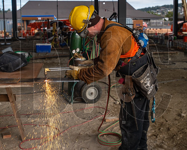 Apprentice ironworker Justin Wickline, a member of Local 29 and an employee of Corona Steel, cuts a piece of steel to be used in replacing a gusset. (Josh Kulla/DJC)