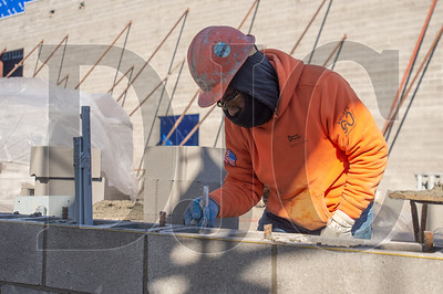 Journeyman mason Horacio Rueda, a member of Local 1 and an employee or Davidson's Masonry, spreads mortar while laying CMU block. (Josh Kulla/DJC)
