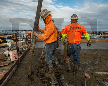 Industrial Concrete employees Jake Bateman, left, and Juan Flores, a member of Local 555 and also an employee of Industrial Concrete, walks past. (Josh Kulla/DJC)
