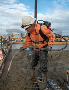 Robert Reed, a journeyman laborer with Local 737 and an employee of T Gerding Construction, vibrates concrete. (Josh Kulla/DJC)