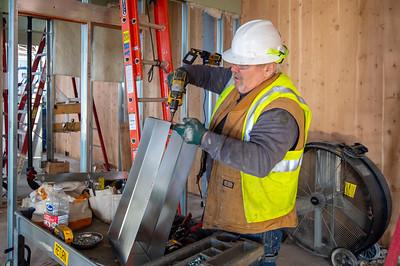 Journeyman sheet metal technician Steve Callahan, a member of Local 16 and an employee of Robert Lloyd Sheet Metal, constructs ductwork. (Josh Kulla//DJC)