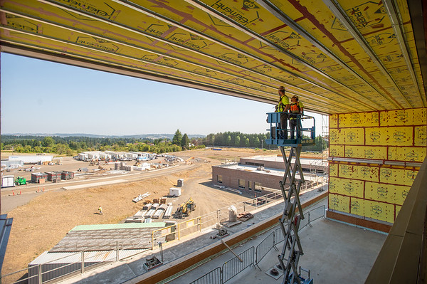 In summer 2019, carpenters framed a ceiling at Sherwood High School. The project is one of many statewide on which construction workers have filed complaints of a lack of social distancing. (Josh Kulla/DJC file)