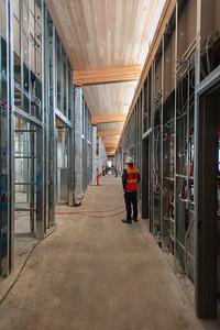 A cross-laminated timber ceiling is visible through the building's main corridor. (Josh Kulla/DJC)