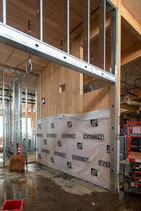 Cross-laminated timber shear walls are built into the structure to provide seismic resilience to keep the building operational after a major earthquake. (Josh Kulla/DJC)