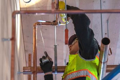 Warren Erickson, an apprentice plumber with Piper Mechanical, solders a copper gas line. (Josh Kulla/DJC)
