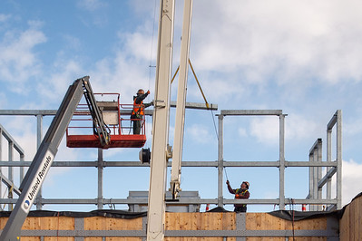 Fabricators with Solid Form Fabrication erect steel framing for the building's rooftop mechanical penthouse. (Josh Kulla/DJC)