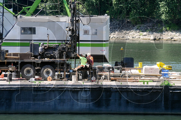 Crews aboard a drilling barge collect core samples from under the Willamette River in Portland on Thursday.  Samples are being collected where temporary piers will be located for a detour bridge being built around the Sellwood Bridge.