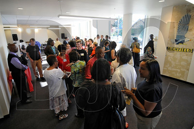 People gather in the recently-completed June Key Delta Community Center for the building's grand opening celebration in North Portland on Wednesday.  The center is the first African-American-owned community building to pursue certification from the Living Building Challenge, a program launched by the Cascadia Green Building Council.