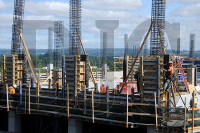 Crews with Andersen Structures work on the parking structure of the Westside Medical Center in Hillsboro on Wednesday.  The structure will feature a rainwater collection system in which water is stored in a tank, then pumped to irrigate plants and fill a landscaped water feature in front of the complex's medical office building.