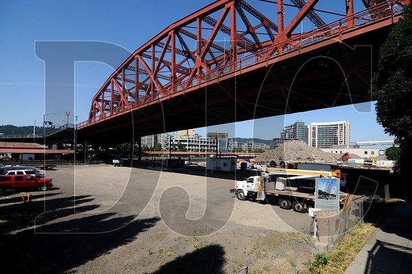 The American Institute of Architects is creating a database of stalled construction projects, such as the proposed One Waterfront Place development in Northwest Portland, to connect developers with investors seeking opportunities.