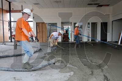 Crews with Tapio Construction Inc. pour self-leveling slab in the showroom of Gresham Ford.