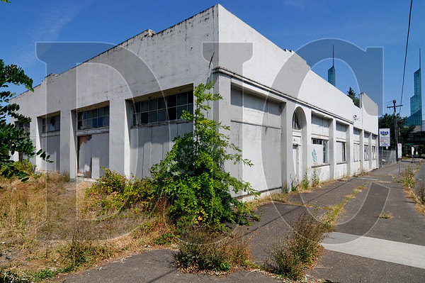 Kalberer Co. is considering revelopment ideas for a .6-acre lot near the Rose Quarter and Convention Center. The 89-year-old warehouse building on the property, located at 7 N.E. Oregon St., formerly housed a truck sales business and repair garage.