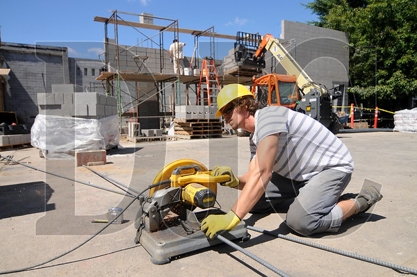 Jesse Gullbergh, a laborer with The Building LLC, cuts rebar at The Breathe Building.