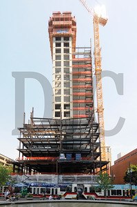 The 30-story Park Avenue West mixed-use tower, being built in downtown Portland by Hoffman Construction Co., continues to rise. The building's concrete core has reached 23 stories, while structural steel being erected around the core's perimeter is quickly catching up. Steel on the buildings east side, which is supporting the project's tower crane, has reached the 17th floor. Ironworkers with REFA Erectors are installing beams, columns, and floor decking, while crews with Hoffman Structures, Inc., the general contractor's concrete subsidiary, are pouring floors. The $131 million project, designed by TVA Architects for owner TMT Development, is slated for completion in December 2015.