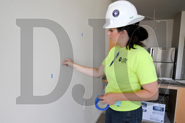 Iris O'Neal, a project engineer with LMC Construction, marks spots for drywallers and painters to touch up in a nearly-finished independent living unit at Larel Parc.