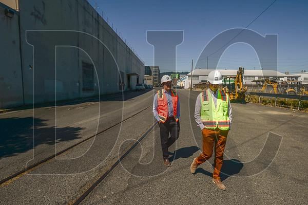Winkler Development Principal Jordan Winkler (left) and R&H Construction Project Manager Kraig O'Connor walk the perimeter of The Hopper project in Northwest Portland. This view faces west up Northwest York Street. (Josh Kulla/DJC)