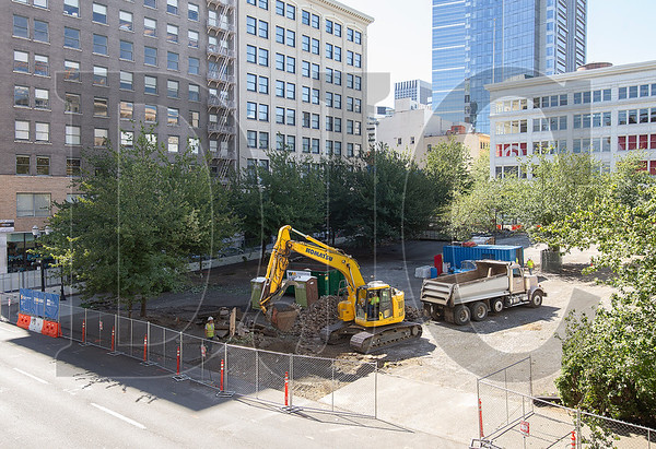 Crews with McDonald Excavating on Thursday began work at the Block 216 site in downtown Portland. A shoring and excavation permit was issued earlier this week for the project, which will be built by general contractor Howard S. Wright. (Sam Tenney/DJC)