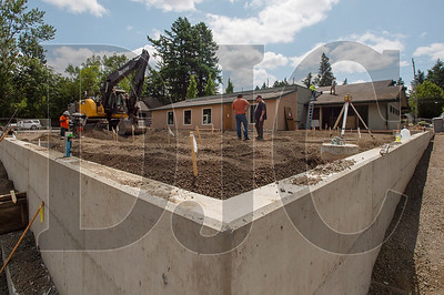 A new retaining wall has been built to provide space for an outdoor children's play area. (Josh Kulla/DJC)