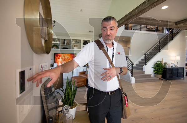 John Cappuccio, chief information officer for West Hills Homes Northwest, demonstrates the use of a Brilliant control panel installed in a home at the Street of Dreams in Wilsonville. (Sam Tenney/DJC)