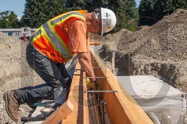 Bill Wantaja, a journeyman electrician with Prairie Electric, places conduit inside foundation formwork. (Josh Kulla/DJC)