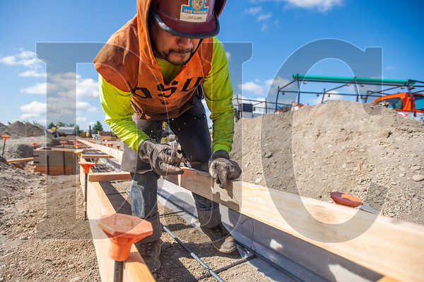 Jose Guzman, a journeyman ironworker with Bar M Steel, ties rebar at the Sifton Elementary School project in Vancouver. (Josh Kulla/DJC)