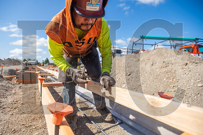 Jose Guzman, a journeyman ironworker with Bar M Steel, ties rebar at the Sifton Elementary School project in Vancouver. (Josh Kulla/DJC)