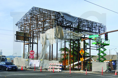 A sculpture being erected on the east end of the Hawthorne Bridge is one of three funded through the city's Percent for Art program as part of the Portland Streetcar's east side expansion.