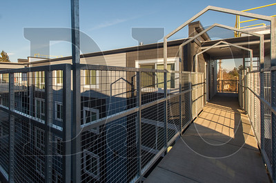 A fourth-story catwalk connects buildings at the Charlotte B. Rutherford Place affordable housing complex in North Portland. (Josh Kulla/DJC)