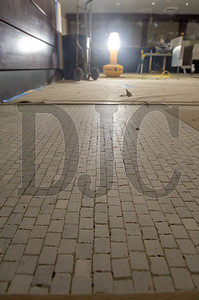 A layer of stone terrazo flooring original to the Multnomah Hotel building was uncovered after contractors removed carpet, wood flooring and several layers of tile.
