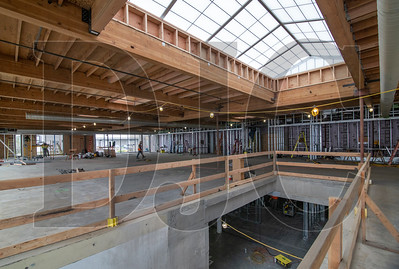 A new skylight illuminates an area where a portion of slab has been cut for the installation of a staircase at R&H Construction's future office space at The Hopper building in Northwest Portland. (Sam Tenney/DJC)