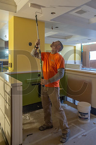 Thad Rogers, a journeyman painter with Rogers Painting, applies a coat of paint to the ceiling of the new Mother's Bistro restaurant.