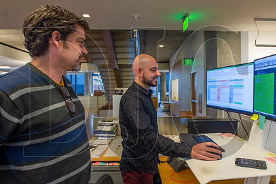 Chris Chatto, left, and Baha Sadreddin use ZGF Architects' new Excel-based life cycle assessment tool for concrete mixtures. (Josh Kulla/DJC)